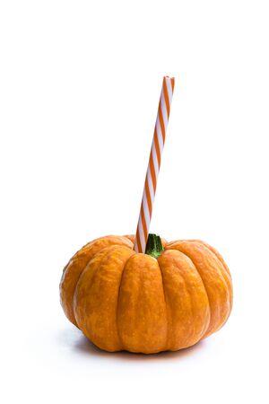 Ripe  orange pumpkin with straw. Halloween cocktail drink concept