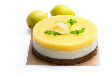 Homemade Layered Lemon Cheesecake isolated on white