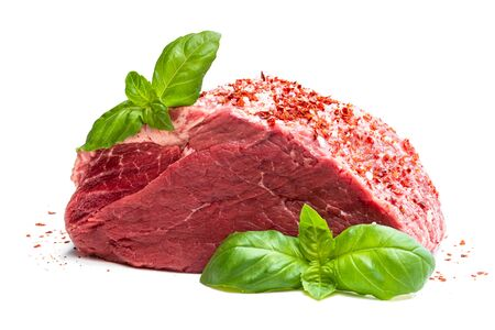 Fresh  raw meat beef piece with spices and basil leaf isolated on white background