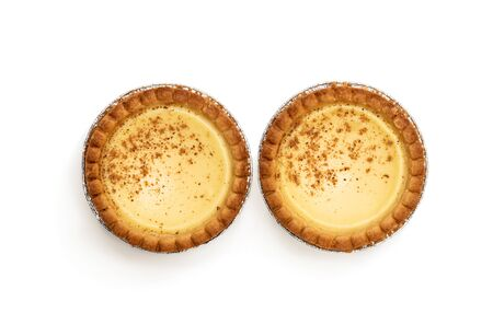 Delicious  freshly baked egg tarts on isolated on white. Top view.