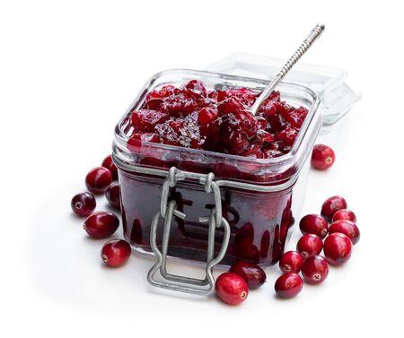 Fresh homemade cranberry sauce in glass jar isolated on white Standard-Bild