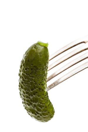 Pickled  cucumber sticking on a fork isolated on white  Stock fotó