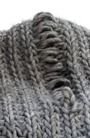 Light grey knitting texture with manufacturing defect isolated on white