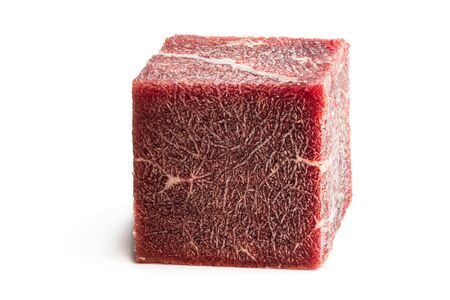 Piece of frozen meat cubic shape concept of routinely eaten food