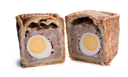 Traditional  English savoury gala egg pork pie isolated on white  Reklamní fotografie