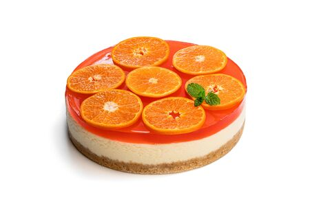 Delicious  cheese cake with jellied layer and oranges on top isolated on white