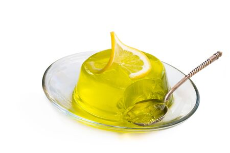 Lemon jelly on glass saucer isolated on white