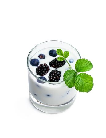 Drinking  yogurt with fresh berries in a glass isolated on white