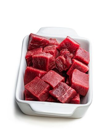 Sliced raw beef isolated on white