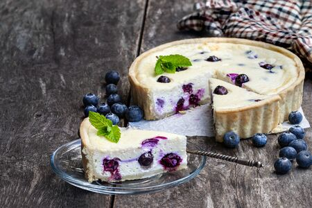 Cheesecake  with blueberry on rustic wooden table