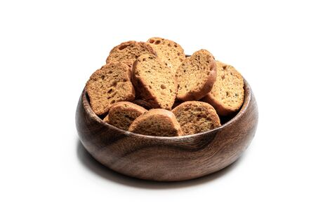 Mini toasts bread in wooden bowl isolated on white background Standard-Bild