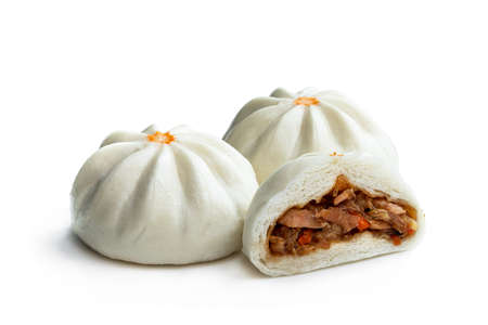 Steamed bao buns with delicious filling isolated on white Stock Photo