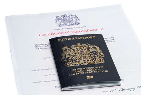 First Iconic blue post brexit 2021 style British passport with naturalization certificate Stock Photo
