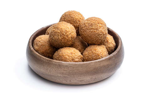 Mini scotch eggs in wooden bowl isolated on white