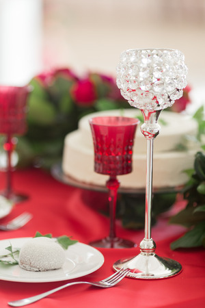 Close up crystal glasses on the red wedding table Stock Photo