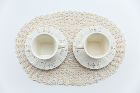 two white cup on the white background