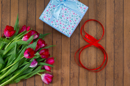 Tulips, gift box and ribbon in shape of number 8. Eight march decoration