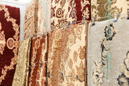 furniture store: Many colorful carpets for sale on a street