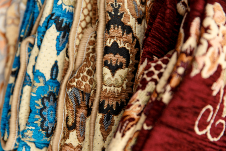 prayer rug: Many colorful carpets for sale on fair. Stock Photo