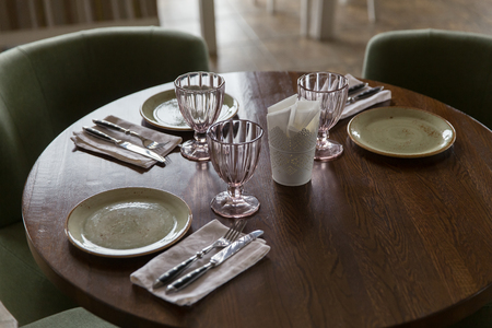 white wine: Empty glasses and dishes set in restaurant.
