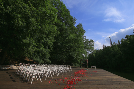 Wedding setup. Wedding ceremony. fragment like view of nice chairs ready for wedding ceremony.