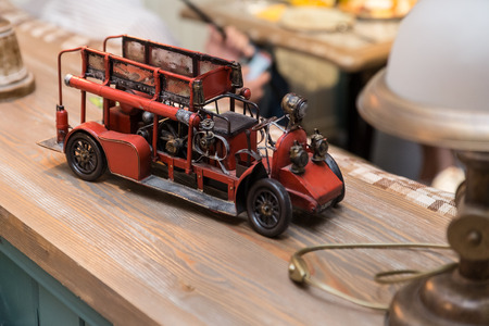 fireman: Antique Toy Fire Engine. Interior detail in a cafe. Stock Photo