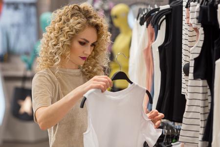 shopper: Young shopper woman choosing clothes. shopping concept Stock Photo