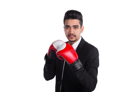 Young man boxer in black suit and red boxing gloves.