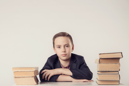 Book, school, kid. Little student holding books. funny crazy boy with books. Looking at camera. School concept. Back to School. Stock Photo
