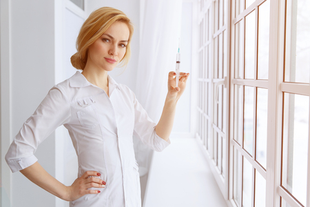Young beautiful women doctor with syringe. Medicine and health care concept Reklamní fotografie