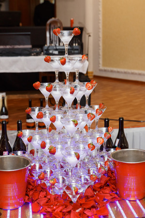 Champagne glasses at the party. Pyramid of champagne. Festive alcohol . Collective drunkenness