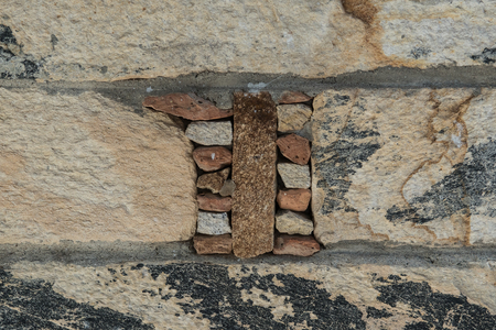 Aged stone, old bricks texture, rocky wall surface closeup. Grunge rock, bathroom or kitchen tile 写真素材