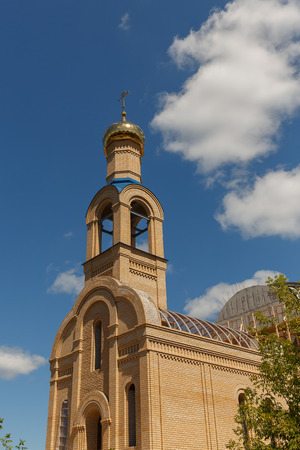 The restored church against the blue sky.