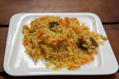 Pilaf of rice with beaf close-up on the plate.