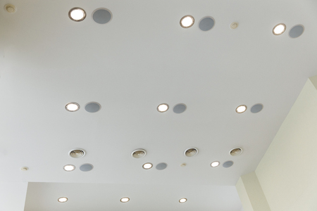 Suspended ceiling and plasterboard with built-in lights in the decoration of the apartment or house.