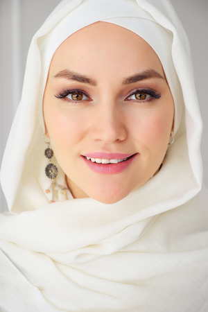 Portrait closeup of muslim woman in hijab smiling and looking at camera, close up Stock Photo