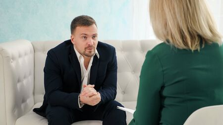 Consultation of a psychologist. Male psychologist consults with a woman in depression