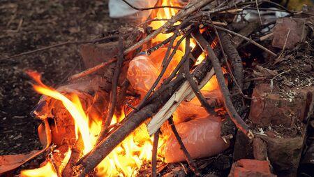 plastic bottles are burning in the firem, close-up Banco de Imagens