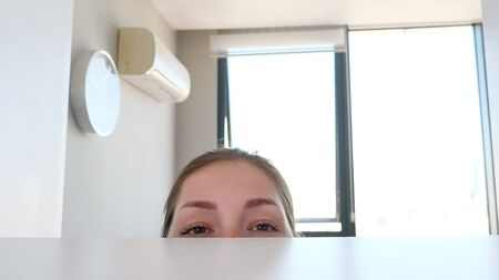 Woman looks for something in the closet, close-up