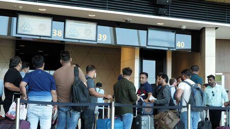Baku, Azerbaijan, 20-05-2019: Passengers are standing in long line waiting passport control on flight in airport terminal. Check in in Baku, Heydar Aliyev airport. Redactioneel