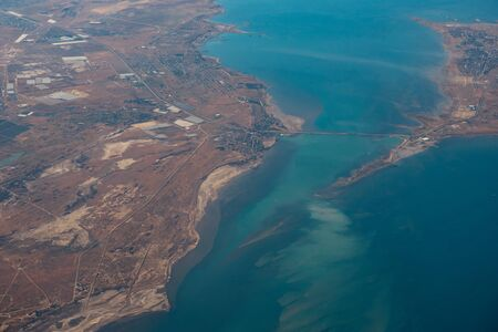 Aerial view of sea islands and boats from the plane, flight to sea vacation.