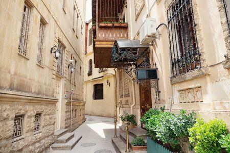 narrow street of the Old city in Baku. Wooden balcony above the passageway. Stock fotó