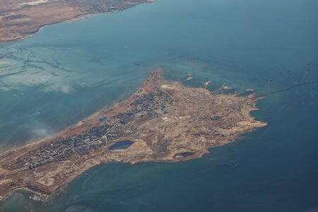 Aerial view of sea islands and boats. Footage from the plane, flight to sea vacation.