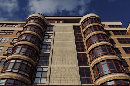 Modern brick house with round loggias. low angle Stock fotó
