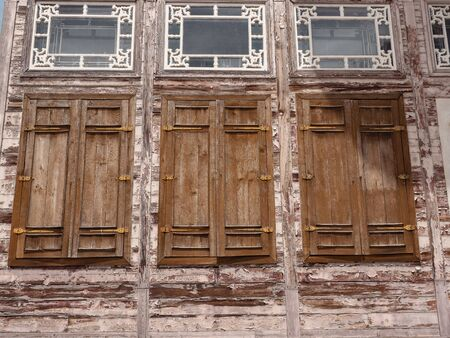 Wooden window shutters in the historic building.