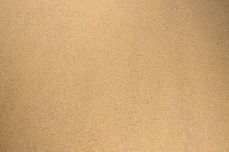 Beige texture. Background of sand with dark splashes. Standard-Bild