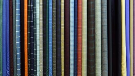 Vertical rolls of colorful fabric background closeup Stok Fotoğraf
