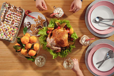 family eat chicken sitting at celebration dinner on christmas eve top view