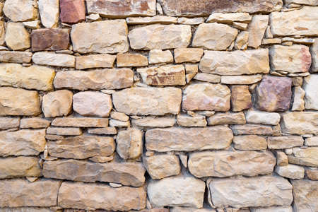 Wall of stones of different sizes, texture.