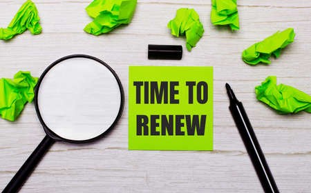 The TIME TO RENEW is written on the green note sticker next to the magnifying glass and black marker.